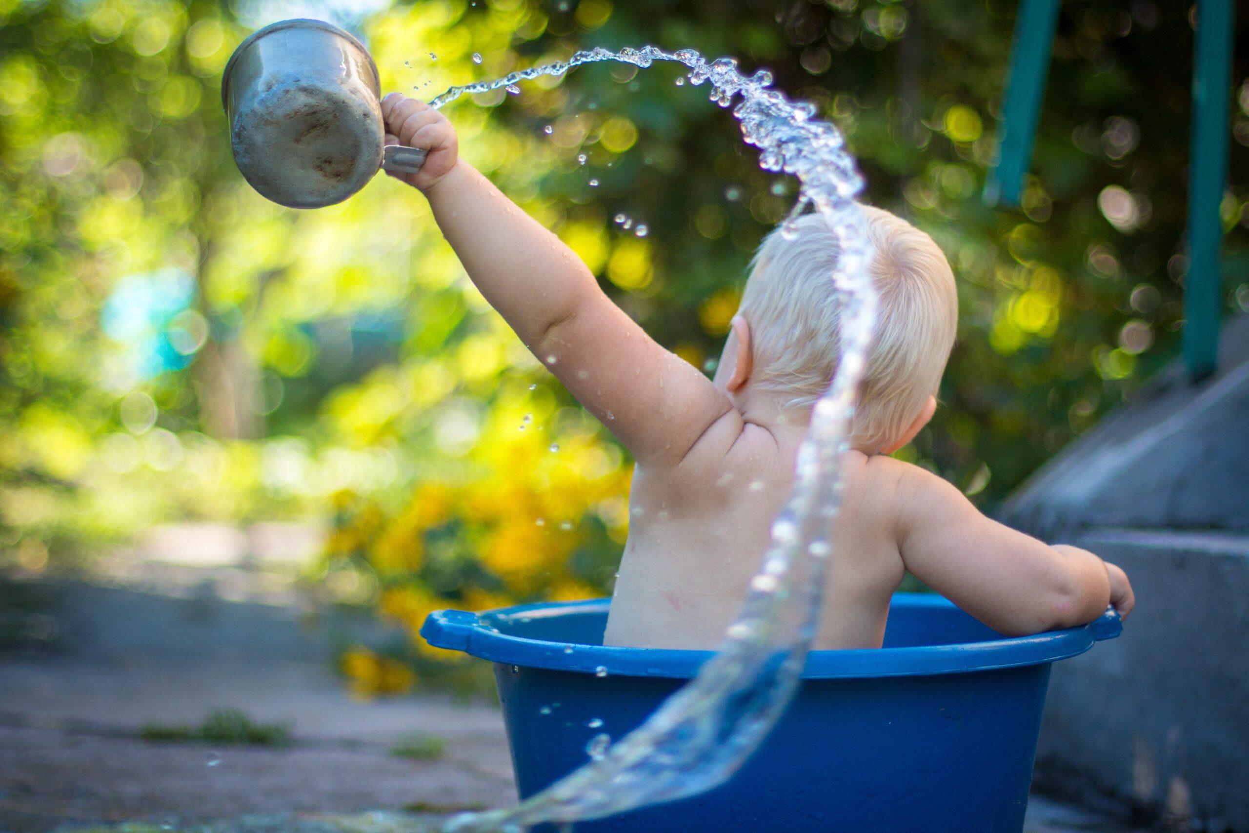 Toddler playing in water